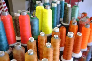 colorful thread on industrial spools